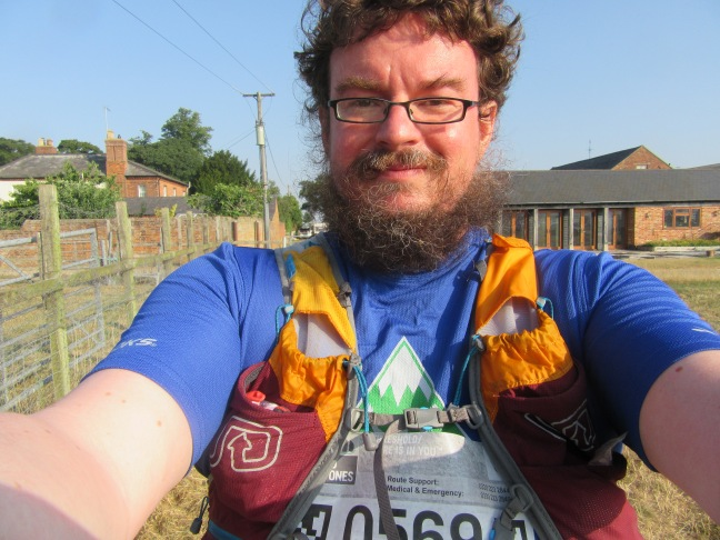selfie of me in running kit with running vest and race bib